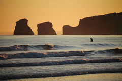 View on man going diving to atlantic ocean in sunrise Stock Photography
