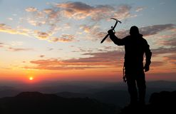 View of man on mountains with ice axe in hand Stock Photography