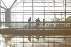 A view of a man walking in an airport. royalty free stock photography