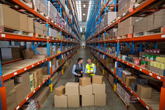 View of managers are checking some cardboard boxes. In a warehouse stock images