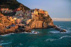 View of Manarola at sunset. View at sunset of Manarola in National Park of Cinque Terre, Ligury, Italy Royalty Free Stock Image