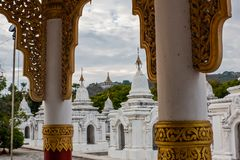 A view on Mandalay Hill from Kuthodaw Pagoda, Mandalay, Myanmar. Kuthodaw Pagoda is a Buddhist stupa, located in Mandalay, Burma, that contains the world`s royalty free stock photo