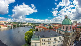 View of the manes bridge with a building of the czech parliament behind it timelapse from Old Town Bridge Tower. stock footage