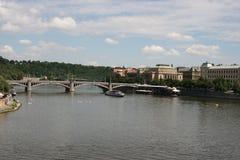 View of Manes Bridge  from Charles Bridge. The Charles Bridge ( Karlův most) is a famous historic bridge that crosses the Vltava river in Prague, Czech Republic Stock Photos