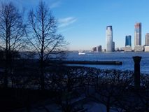 View from Manhattan across Hudson River to Jersey City skyline. Bright clear sky. North Cove Marina in Manhattan, looking across at skyscrapers along the stock photo