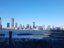 View from Manhattan across Hudson River to skyline in New Jersey. Bright clear sky. North Cove Marina in Manhattan, looking across at skyscrapers at Exchange royalty free stock image