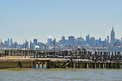 View of Manhattan across river Hudson with wooden Pier in foreground Stock Photo