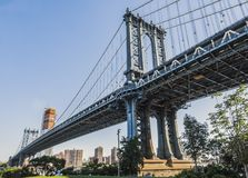 A view of the Manhattan Bridge from Brooklyn early in the morning with blue sky and sun shine Royalty Free Stock Photography