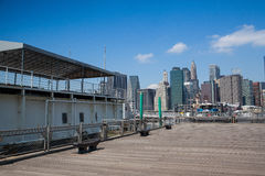 View of Manhattan from ferry harbor in Brooklyn Royalty Free Stock Image