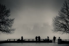 View of Manhattan, New York, from Liberty Island in a foggy day. Stock Photography