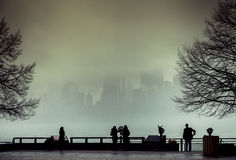 View of Manhattan, New York, from Liberty Island in a foggy day. Royalty Free Stock Images