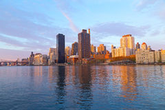 A view on Manhattan from Roosevelt Island at sunrise, New York, USA. Stock Image