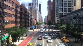 View of Manhattan`s 2nd Avenue as Seen from Roosevelt Tramway. NEW YORK - Circa July, 2016 - A view up 2nd Avenue in Manhattan as seen from the Roosevelt Tramway stock video footage