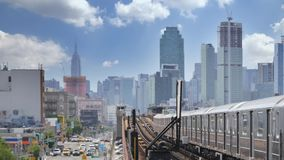 View of Manhattan Skyline as Seen from Elevated Subway Platform in Queens. 8723 A view of the Manhattan skyline as seen from an elevated subway platform over stock footage