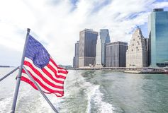 View of Manhattan skyline and flag of USA Royalty Free Stock Image
