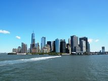 Manhattan Skyline from New York Harbor. View of Manhattan from the Staten Island Ferry on a clear sunny day. One World Trade and other landmarks visible Stock Photos