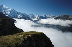 View from Mannlichen at the Bernese Alps (Berner Oberland, Switzerland). The Mannlichen is a mountain (2,343 metre) in the Swiss Alps located within the Canton Royalty Free Stock Photos
