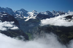 View from Mannlichen at the Bernese Alps (Berner Oberland, Switzerland). The Mannlichen is a mountain (2,343 metre) in the Swiss Alps located within the Canton Royalty Free Stock Images