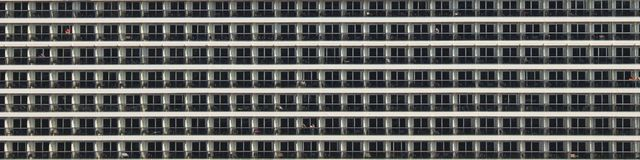 A view of many balconies of a cruise ship. stock photos