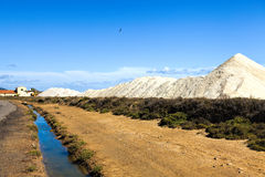 View of many salt mountains under blue skies Royalty Free Stock Photo