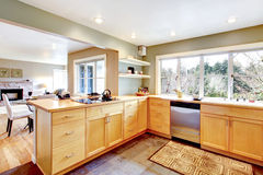 View of the maple kitchen with open wall design Stock Photography