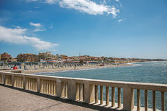 View of marble pier, with the beach and the city of Ostia. royalty free stock photo