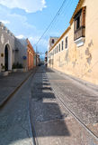 View of Mariano Corona street with locals and old tramway rails Stock Image