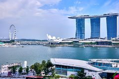 View of Marina Bay with the famous Singapore Flyer and the Merlion at the Clarke Quay royalty free stock images