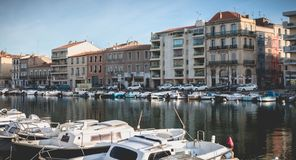 View of the marina in the city center of Sete, France. Sete, France - January 4, 2019: view of the marina in the city center where pleasure boats are parked on a stock image