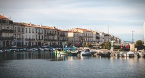 View of the marina in the city center of Sete, France. Sete, France - January 4, 2019: view of the marina in the city center where pleasure boats are parked on a stock photography