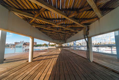 View of marina Port Vell from under the pedestrian walkway concourse that connects the entertainment & shopping centre to the city. View toward shoreline & Royalty Free Stock Photos