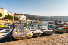 View of the marina in small town Pag, a very popular destination among tourists Stock Images