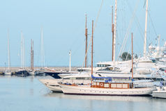 Yachts in the marina. Yachts in the classical style Royalty Free Stock Images