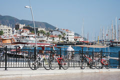 View of Marmaris Turkey. MARMARIS, TURKEY - SEPTEMBER 11 View of Marmaris in 2012 with bicycles on front plan and ships buildins castle and mountains on Royalty Free Stock Image