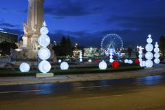 View of the Marques de Pombal square with Christmas lights and a ferris wheel on the background, in Lisbon. Lisbon, Portugal - December 17, 2016: View of the stock photo