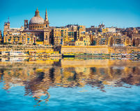 View of Marsamxett Harbour and Valletta. Scenic View of Marsamxett Harbour and Valletta in Malta with reflection Stock Image