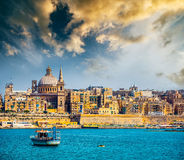 View of Marsamxett Harbour and Valletta. Scenic View of Marsamxett Harbour and Valletta in Malta at sunset Stock Photos