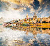 View of Marsamxett Harbour and Valletta. Scenic View of Marsamxett Harbour and Valletta in Malta at sunset with reflection Royalty Free Stock Image