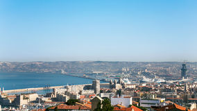 View of Marseilles city and port under blue sky. Travel to Provence, France - above view of Marseilles city and port under blue sky Stock Photo