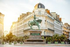 Orleans city in France. View on the Martroi square with statue of Saint Joan of Arc in Orleans city during the sunset in France stock photography