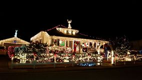 View of maryville tn best Christmas lights. Ted, green, white, santa, house covered bright holiday lights Stock Image