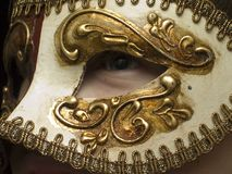 View through the mask. Eye from under the carnival mask Stock Image