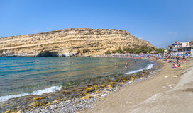 View on Matala beach, located on Crete island Royalty Free Stock Photos