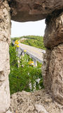 View on Matanzas bridge through window in stone wall. View on sunlit Matanzas bridgethrough window in stone wall in Cuba Stock Images
