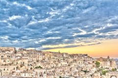 View of Matera, Italy, UNESCO at sunset Stock Photos