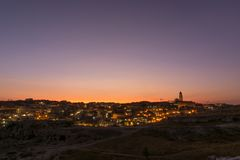 Sunset over Matera, basilicata, Italy. View of Matera during sunset, from the park of Murgia Materana. Romantic sunset over the italian city of Matera stock image