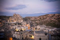 view of the matera town landscape at sunset on cloudy sky background royalty free stock photo