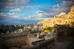 view of the matera town landscape at sunset on cloudy sky background royalty free stock photography