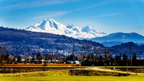 View from the Matsqui at the towns of Abbotsford and Mission in British Columbia, Canada. With Mount Baker in the background stock photography