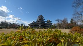 Matsumoto castle with a beautiful foreground in Matsumoto, Nagano, Japan. View of Matsumoto castle with a beautiful foreground in Matsumoto, Nagano, Japan stock photo